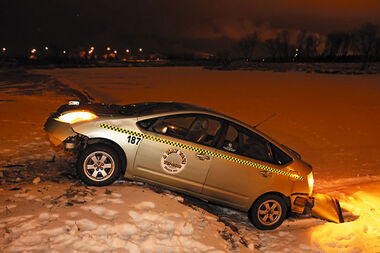 A Toyota Prius sits stuck against the north bank of the Assiniboine River near the 18th Street Bridge on Thursday evening after leaving 18th Street at Eleanor Kidd Park, launching off the south bank of the river and driving across the river. Brandon police are investigating the incident and believe the car may have been stolen.