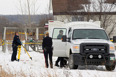 RCMP officers and Dakota Ojibway Police Service officers work at the scene of two fatalities at a home at Sioux Valley Dakota Nation on Friday evening.