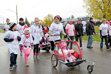 Sunday's cold and rainy weather didn't deter walkers and runners from taking part in the annual run in support of the Canadian Breast Cancer Foundation.