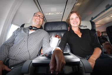 Derek Brown and Katherine Pachkowski sit hand-in-hand somewhere over the Great Lakes on WestJet's inaugural flight from McGill Field in Brandon to Toronto's Pearson International Airport. Pachkowski surprised Brown with the flight for his birthday.
