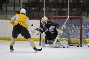 Brandon Wheat Kings netminder Logan Thompson makes a save as forward Reid Duke looks for a rebound as the team practised for the first time at Credit Union Place in Dauphin on Monday. Their quarter-final series with the Medicine Hat Tigers resumes tonight with Game 3 in Dauphin.