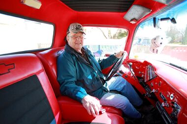 Wayne Lindberg sits in his restored 1957 Chevy half-ton at his home in Brandon — one of several vehicles he has fixed up. Lindberg and his wife, Barbara, will be showing off their classic vehicles at area car shows this summer, including the monthly Cruise Night in Downtown Brandon events that begin May 18.