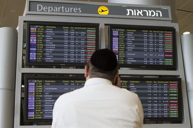 A departure flight board displays various canceled and delayed flights in Ben Gurion International airport in Tel Aviv, Israel, Wednesday, July 23, 2014. THE CANADIAN PRESS/AP, Dan Balilty