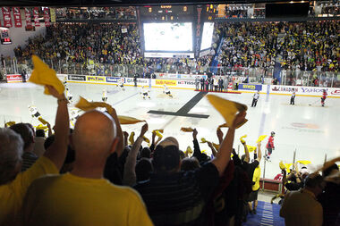 Wheat Kings fans cheer at the start of the 2010 MasterCard Memorial Cup championship game at Westman Place on May 23, 2010.