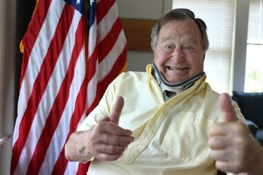 In this Thursday, July 30, 2015, photo provided by the Office of George H. W. Bush, former President George H.W. Bush wears a neck brace at his summer home in Kennebunkport, Maine. The 91-year-old tweeted the photo showing him in the brace and giving two thumbs up Thursday. Bush fractured a bone in his neck when fell there on July 15. Doctors are letting the fractured vertebra heal on its own over the next several months. (Office of George H. W. Bush via AP) MANDATORY CREDIT