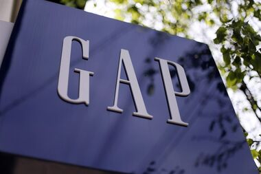 FILE - This photo May 14, 2014 file photo shows signage outside a Gap store in the Shadyside section of Pittsburgh. Stores operated by Gap Inc. in Canada will join their U.S. counterparts in ending the practice of requiring workers to be on call for short-notice shifts. THE CANADIAN PRESS/AP,Gene J. Puskar