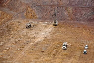 In this Jan. 29, 2014 photo, a drill finishes up the blast pattern at Barrick Gold Corp.'s Cortez Hills, Nev., open pit site. THE CANADIAN PRESS/AP, Elko Daily Free Press, Ross Andreson