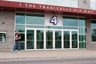 A man walks by the Rogers K-Rock Centre on The Tragically Hip Way in Kingston, Ont., on Wednesday May 25, 2016. Ontario's attorney general says she's prepared to try and find out why so many Tragically Hip fans couldn't buy tickets for their summer concerts — unless they wanted to pay many times face value on resale sites.THE CANADIAN PRESS/Lars Hagberg