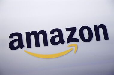 FILE - In this Sept. 28, 2011 file photo, the Amazon.com logo is displayed at a news conference in New York. The e-commerce powerhouse on Tuesday, Sept. 1, 2015 said it will now let members of its $99 annual Prime loyalty program download some shows and movies on its streaming video service to watch offline, or when there is no Internet connection available, for free. (AP Photo/Mark Lennihan, File)