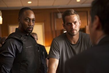 This image released by Relativity Media shows RZA, left, and Paul Walker in a scene from