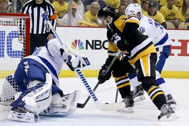 Pittsburgh Penguins' Bryan Rust, center, scores past Tampa Bay Lightning goalie Andrei Vasilevskiy, left, as Tampa Bay Lightning's Alex Killorn (17) defends during the second period of Game 7 of the NHL hockey Stanley Cup Eastern Conference finals, Thursday, May 26, 2016, in Pittsburgh. (AP Photo/Gene J. Puskar)