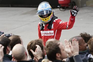 Ferrari driver Fernando Alonso of Spain celebrates after winning the third place after the Chinese Formula One Grand Prix at Shanghai International Circuit in Shanghai, Sunday, April 20, 2014. (AP Photo/Alexander F. Yuan)