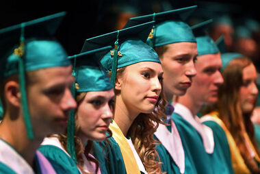 Christina Munchinsky, third from left, listens to speeches during École secondaire Neelin High School's graduation ceremony at the Western Manitoba Centennial Auditorium on Thursday.