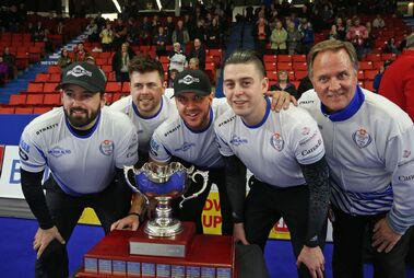 Reid Carruthers (left), Braeden Moskowy, Derek Samagalski, Colin Hodgson and Dan Carey pose with the trophy after winning the mens final in the Canada Cup of curling, Sunday evening at the Keystone Centre.