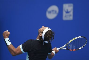 Rafael Nadal of Spain reacts after defeating Fabio Fognini of Italy in the men's singles semifinals match of the China Open tennis tournament at the National Tennis Stadium in Beijing, Saturday, Oct. 10, 2015. (AP Photo/Andy Wong)