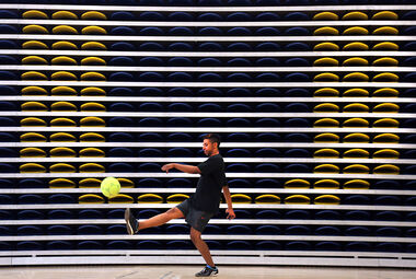 Moe Al-Naamani kicks a soccer ball in the Brandon University gym on Monday. BU's Score a Seat campaign, launched near the end of June, is more than a third of the way to its goal of selling 150 seats by the end of the year.