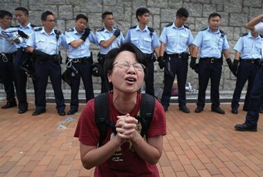 A student protester gets emotional while pleading for a peaceful resolution, Thursday, Oct. 2, 2014 in Hong Kong. The student leaders of the protests are warning that if the territory's top official doesn't resign by tomorrow, they will step up their actions -- including occupying several important government buildings. They'd be risking another round of confrontations with police, who are unlikely to let government buildings be stormed. (AP Photo/Wong Maye-E)