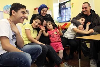 Parents Abdul Salam Mousa and Nafsa Mousa sit with their children (from left) Imran, Noor Elddin, Bilasan and Kamal during an interview at Westman Immigrant Services. The Mousa family left Syria in 2012, then travelled from Jordan to Canada four years later. Imran and Noor Elddin are in the English as an Additional Language program at École New Era School.
