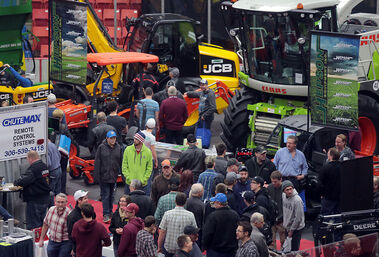 Visitors to Ag Days make their way through the main arena during the opening day of the annual agriculture expo at the Keystone Centre on Tuesday.