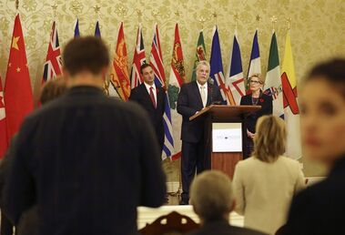 Quebec Premier Philippe Couillard, center, speaks at the Chinese People Association for friendship in Beijing, China Thursday, Oct. 30, 2014. THE CANADIAN PRESS/AP, Andy Wong