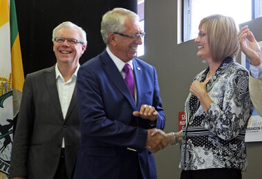 Brandon-Souris Conservative MP Larry Maguire, shaking hands with Mayor Shari Decter Hirst, with Premier Greg Selinger looking on, all had reason to smile during an announcement Tuesday that the federal government will commit up to $2.9 million for the city's airport terminal expansion.