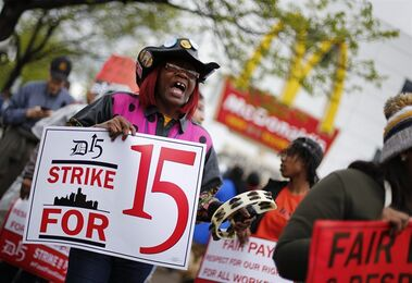 FILE - In this Thursday, May 15, 2014, file photo, Velma Cornelius protests for higher wages outside a McDonald's restaurant in Detroit. McDonald's, Wendy's and other fast-food restaurants are expected to be targeted with acts of civil disobedience that could lead to arrests Thursday, Sept. 4, 2014, as labor organizers escalate their campaign to unionize the industry's workers. (AP Photo/Paul Sancya, File)