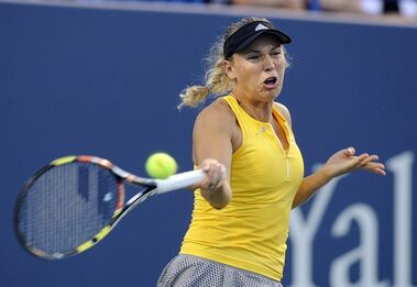Caroline Wozniacki, of Denmark, hits a forehand to Petra Kvitova, of the Czech Republic, during the semifinals of the Connecticut Open tennis tournament in New Haven, Conn., on Friday, Aug. 28, 2015. (AP Photo/Fred Beckham)