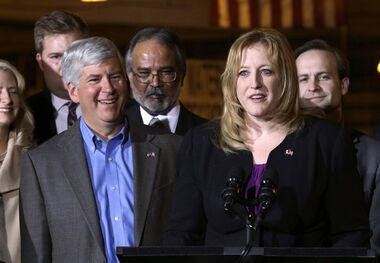 Lisa Raitt speaks as Michigan Gov. Rick Snyder, left, listens during the announcement the United States State Department issued a key permit to build a second bridge linking the United States and Canada from Detroit to Windsor, Ontario during a news conference in Detroit. in Detroit, Friday April 12, 2013. Raitt and Snyder are expected to make an announcement Wednesday about a new bridge between Detroit and Windsor, Ont. THE CANADIAN PRESS/AP Photo/Paul Sancya
