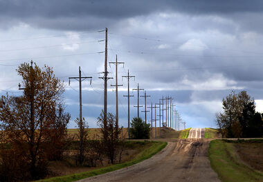 Sunlight breaks through a cloudy sky to illuminate a country road south of Brandon on Monday afternoon.