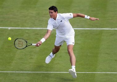 Milos Raonic of Canada plays a return to Pablo Carreno Busta of Spain during their men's singles match on day one of the Wimbledon Tennis Championships in London, Monday, June 27, 2016. (AP Photo/Tim Ireland)