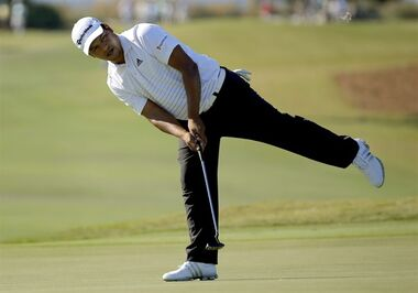 Fabian Gomez, of Argentina, reacts after making a birdie putt on the 15th green during the third round of the McGladrey Classic golf tournament on Saturday, Oct. 25, 2014, in St. Simons Island, Ga. (AP Photo/Stephen B. Morton)