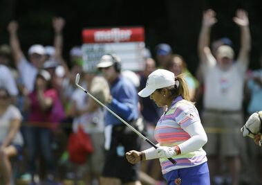 Lizette Salas and fans react after her approach shot for a bogey on the tenth hole during the final round of the Meijer LPGA Classic golf tournament Sunday, July 26, 2015, in Belmont, Mich. (AP Photo/Carlos Osorio)
