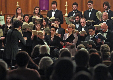 Andrée Dagenais conducts the Brandon University Concert Choir during a performance of the Mozart Requiem at St. Matthew's Cathedral on Tuesday evening.