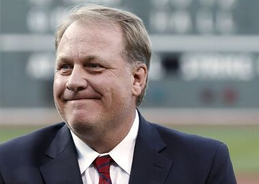 FILE In this Aug. 3, 2012, file photo, former Boston Red Sox pitcher Curt Schilling reacts after being introduced as a new member of the Boston Red Sox Hall of Fame, at Fenway Park in Boston. ESPN says commentator Schilling won't appear on the air for the next month in the wake of his anti-Muslim tweet. ESPN said Thursday, Sept. 3, 2015, that Schilling won't be on telecasts for the rest of the regular season or the American League wild-card game on Oct. 6. The former star pitcher and