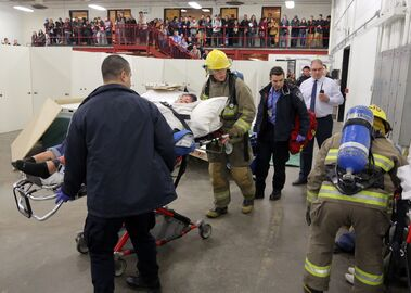 Students take part in a mock disaster exercise at Assiniboine Community College during the college's open house on Thursday. The scenario had students and faculty from several programs showcasing careers in different disciplines and how they're connected.