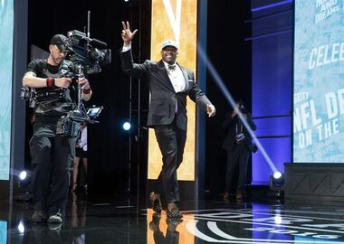 Mississippi's Laremy Tunsil walls on the stage after being selected by the Miami Dolphins as the 13th pick in the first round of the 2016 NFL football draft, Thursday, April 28, 2016, in Chicago. (AP Photo/Charles Rex Arbogast)
