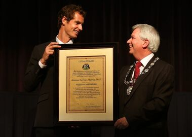 British tennis player Andy Murray, left, receives the Freedom of Stirling presented to him by Stirling Council Provost Mike Robbins during a special council meeting at his old school Dunblane High, in Dunblane, Scotland, Wednesday, April 23, 2014. Murray said he feels honored to receive the freedom of Stirling and an honorary degree from the university where he trained as a boy. (AP Photo/PA, Andrew Milligan) UNITED KINGDOM OUT, NO SALES, NO ARCHIVE