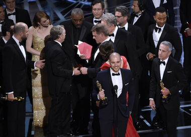 Fred Berger, foreground centre, and the cast of La La Land mistakenly accept the award for best picture at the Oscars. The winner was Moonlight.