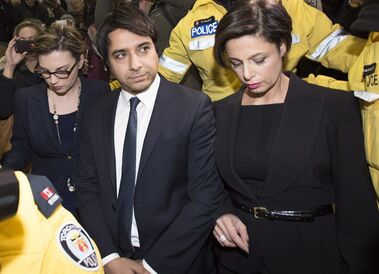 Jian Ghomeshi leaves court in Toronto, Wednesday, Nov.26, 2014. Ghomeshi has been granted bail just hours after being charged with multiple counts of sexual assault.THE CANADIAN PRESS/Nathan Denette