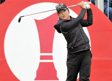 Lydia Ko of New Zealand tees off from the 1st during the third day of the Women's British Open golf championship on the Turnberry golf course in Turnberry, Scotland, Saturday, Aug. 1, 2015. (AP Photo/Scott Heppell)