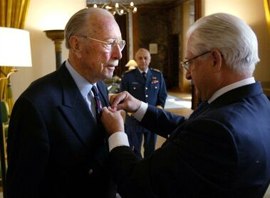Ernest Cote receives his Legion of Honour Award from the Ambassador of France, Phillippe Guelluy, at the French Embassy to Canada in Ottawa on Thursday May 27, 2004. Cote, one of Canada's better known D-Day veterans, has passed away. He was 101. THE CANADIAN PRESS/Tobin Grimshaw
