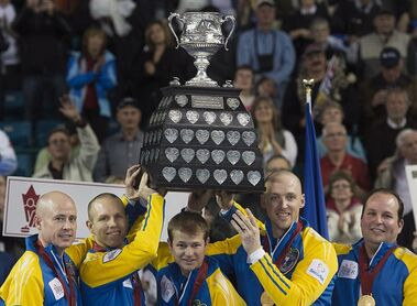 Alberta's Kevin Koe, Pat Simmons, Carter Rycroft, Nolan Thiessen and Jamie King, left to right, hold the Brier Tankard trophy after defeating British Columbia 10-5 to win gold at the Tim Hortons Brier in Kamloops, B.C. on Sunday, March 9, 2014. THE CANADIAN PRESS/Andrew Vaughan