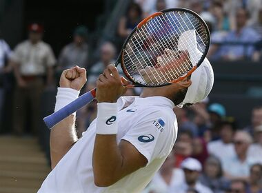 Vasek Pospisil of Canada celebrates defeating James Ward of Britain during their singles match at the All England Lawn Tennis Championships in Wimbledon, London, Saturday July 4, 2015. Pospisil won the match 6-4, 3-6, 2-6, 6-3, 8-6. (AP Photo/Kirsty Wigglesworth)