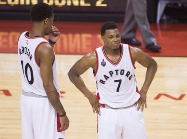 Toronto Raptors guard Kyle Lowry (7) looks on with teammate DeMar DeRozan (10) while playing against the Cleveland Cavaliers during econd half Eastern Conference final NBA playoff basketball action in Toronto on Friday, May 27, 2016. THE CANADIAN PRESS/Nathan Denette