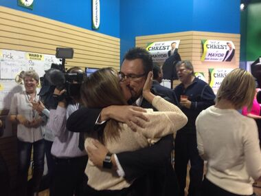 Rick Chrest kisses his wife Karen after it became clear that he would win the Brandon mayoral race on Wednesday evening.