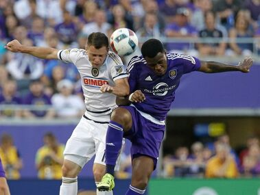 Philadelphia Union's Keegan Rosenberry, left, and Orlando City 's Cyle Larin try to get possession of the ball as they go up for a header during the first half of an MLS soccer game, Wednesday, May 25, 2016, in Orlando, Fla. (AP Photo/John Raoux)