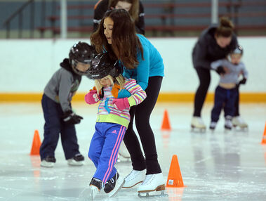 Skate Brandon member Marijka Popadynetz helps Olivia, a novice skater, through an obstacle coarse during Sunday's Skate Canada Day open house held at the Optimist Arena. Sunday was Skate Canada Day, with local figure skating clubs, including Skate Brandon, hosting free trial skate sessions under the watchful eye of club coaches.