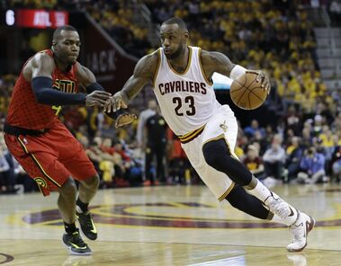 Cleveland Cavaliers' LeBron James (23) drives on Atlanta Hawks' Paul Millsap (4) in the second half in Game 1 of a second-round NBA basketball playoff series, Monday, May 2, 2016, in Cleveland. (AP Photo/Tony Dejak)