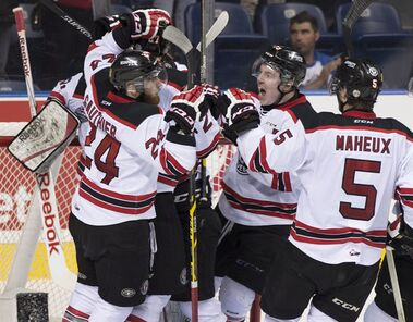 Quebec Remparts players gather around goalie Zachary Fucale after they won the tie breaker game against Rimouski Oceanics, Thursday, May 28, 2015 at the Memorial Cup in Quebec City. Quebec Remparts will play the semi-final game against Kelowna Rockets on Friday night. Guillaume Gauthier, from the left, Zachary Fucale (behind) Adam Erne and Raphael Maheux. THE CANADIAN PRESS/Jacques Boissinot