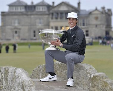Danish golfer Thorbjorn Olesen holds the Dunhill Cup on the iconic Swilken Bridge after winning the Alfred Dunhill Links Championship at The Old Course, St Andrews, Scotland, Sunday Oct. 4, 2015. Denmark's Olesen claims his third European Tour title on Sunday, carding a final round of 71 to finish 18 under. (Ian Rutherford / PA via AP) UNITED KINGDOM OUT - NO SALES - NO ARCHIVES